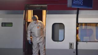Police inspect a crime scene inside a Thalys train of French national railway operator SNCF at the main train station in Arras, northern France, on August 21, 2015