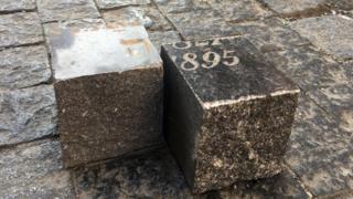 Prague cobblestones made of gravestones cut into squares