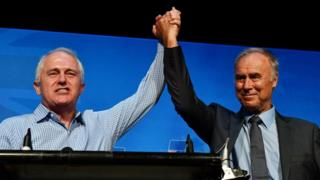 Prime Minister Malcolm Turnbull and newly re-elected Liberal member for Bennelong John Alexander celebrate at the by-election night party at the West Ryde Leagues Club in Sydney, Australia, on 16 December 2017