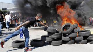 Protestors burned tyres in front of Nissan's plant in Barcelona which is being closed down
