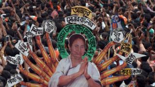 Indian Trinamool Congress Party (TMC) activists attend a mass meeting addressed by West Bengal chief minister and TMC chief Mamata Banerjee in Kolkata on July 21, 2015.