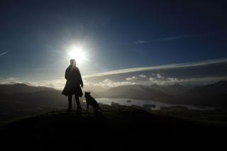 A fell walker enjoys the panoramic views from on top of Latrigg in the Lakeland Fells on December 4, 2009 in Keswick