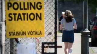 Woman at polling station