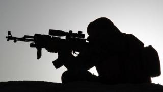 Photo of a solider in silhouette
