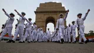 """Indian soldiers leave after a ceremony to honor soldiers killed in action on occasion of 50th anniversary of India""""s win over Pakistan in the war of 1965, at the India Gate war memorial in New Delhi, India, Friday, Aug. 28, 2015."""