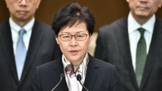 Hong Kong Chief Executive Carrie Lam (C) speaks during a press conference in Hong Kong on August 5, 2019