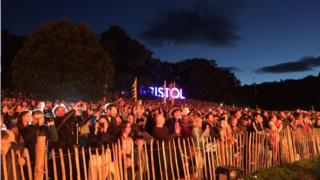 Crowd watches night glow