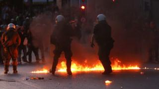 Greek riot police disperse protesters