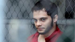 Esteban Santiago escorted from jail