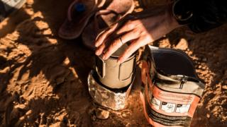 Freeze-dried food and a camping stove in the Sahara desert