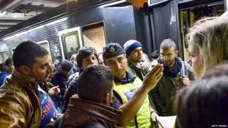 Refugees arrive at Stockholm station