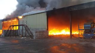 Fire scene shows building well ablaze