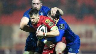 Tom Williams of Scarlets is tackled by Jack Conan and Barry Daly of Leinster