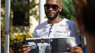 Cuban MLB player Alexei Ramirez shows a magazine before a press conference at the National Hotel in Havana, on December 15, 2015