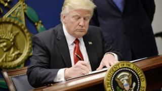 US President Donald Trump signs executive orders in the Hall of Heroes at the Department of Defence on 27 January, 2017 in Arlington, Virginia