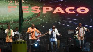 Ivory Coast's music band Magic System performs on stage during the opening ceremony of the FESPACO Panafrican Film and Television Festival of Ouagadougou, in Burkina Faso, on February 23, 2019