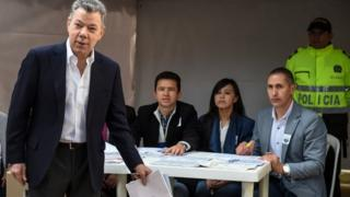 Colombian President Juan Manuel Santos casts his vote at a polling station in Bogota during parliamentary elections in Colombia, on March 11, 2018.