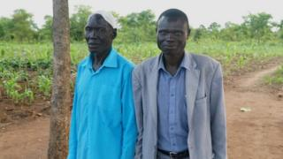 Issa Agub (L) and the refugee he gave land to pictured in Uganda