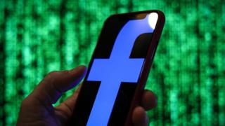 Facebook logo seen on phone screen