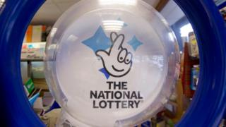 File photo of a national lottery ticket stand logo.
