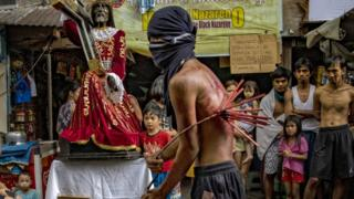 A flagellant in Manila, Philippines, whips his back as penance, defying government orders to avoid religious ceremonies - 10 April