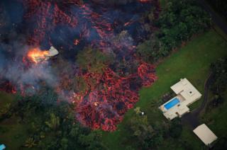 Lava approaches a home near Pahoa, Hawaii