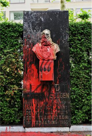This picture taken on June 18, 2020, shows a statue of King Leopold II of Belgium besmirched with red paint, in Gent. - The statue will be removed, amidst discussions to topple all Leopold 2 statues due to the misdeeds in his former colony Congo.
