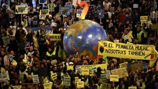 Demonstrators with a balloon in the shape of the Earth take part in a mass climate march