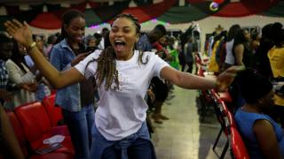 Worshippers are seen celebrating the cross-over into the year 2020 during new year celebrations at Living Faith Church in Abuja, Nigeria January 1, 2020