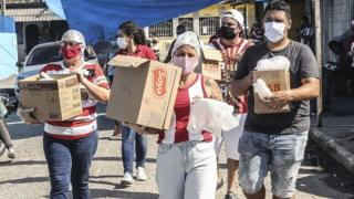 Volunteers in Brazil delivering food supplies to those in need.
