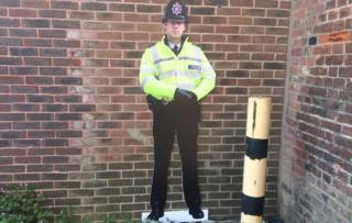 Cardboard cut-out police officer