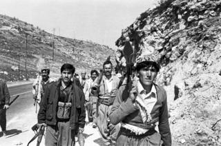 Fighters from the Kurdistan Front move to frontline positions