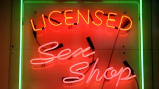 A picture of neon sex shop sign