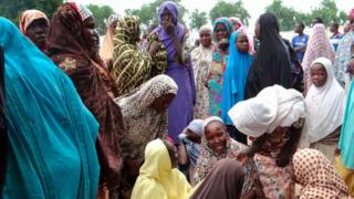 Mourners react on July 24, 2017, in the Dalori IDP (Internally Displaced People) camp outside Maiduguri, after a suicide bomb attack that killed four