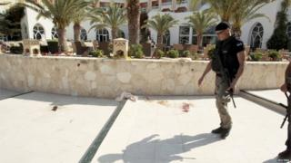 Police officer outside hotel in Sousse, Tunisia, following attack on 26 June 2015