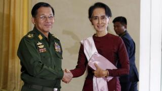 "Myanmar""s Commander-in-Chief Min Aung Hlaing (L) shakes hands with National League for Democracy (NLD) party leader Aung San Suu Kyi"