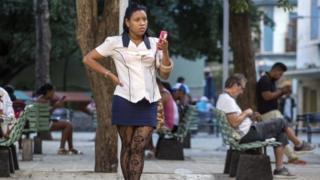 Cubans use a public Wi-Fi spot in Havana, 26 Nov 16