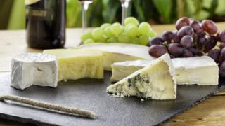 Cheeseboard on a table with grapes
