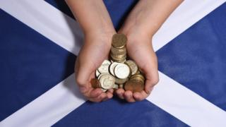 Money being held over Saltire