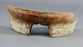 A fragment of pottery used in the brewing process.