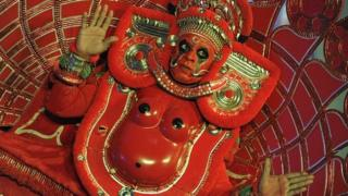 An Indian artist performs a popular ritual dance