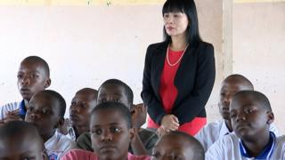 Wang Li Hong Sooma in a class in Kampala, Uganda