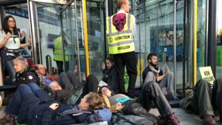 Protesters blockading the offices of the UK's energy department