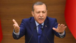 Turkish President Recep Tayyip Erdogan gestures as he delivers a speech in Ankara on 16 March 2016