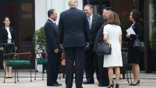 North Korea's leader Kim Jong-un, US President Donald Trump, Kim Yong Chol, Vice Chairman of the North Korean Workers' Party Committee, and US Secretary of State Mike Pompeo talk while Kim Yo-jong looks on from a distance