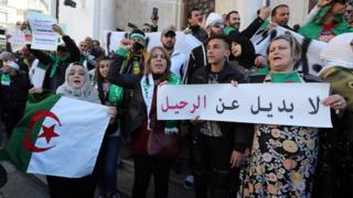 "Algerian protesters written in Arabic ""no alternative than departure"" during a protest against extending President Abdelaziz Bouteflika mandatin in Algiers, Algeria"