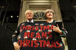 Madame Tussauds figures of Prime Minister Theresa May and Foreign Secretary Boris Johnson dressed in one Christmas sweater.