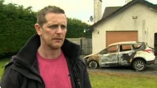 David Mooney and the burnt-out car