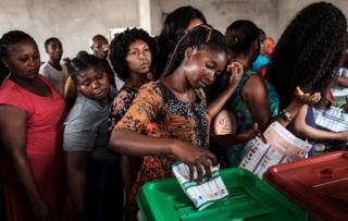 A woman casts her ballot as she votes in the presidential and parliamentary elections on February 23, 2019, at a polling station in Port Harcourt, southern Nigeria