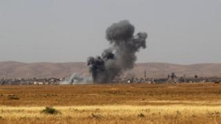 Smoke billows as Iraqi forces and militia fighters advance towards the city of Tal Afar. 20 Aug 2017